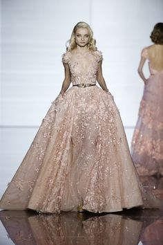 Like the dress but the girl looks like she is right pissed of at someone. Zuhair Murad spring 2015