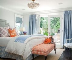 LOVE The mixture of colors in this pretty, inviting bedroom!