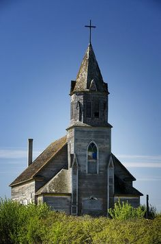 The flora around this elegant, old church tells of time passed!