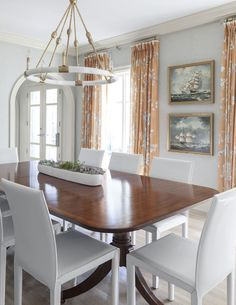 chandelier from blue print and long white trough | formal dining rooms design by collins interiors | blue print |