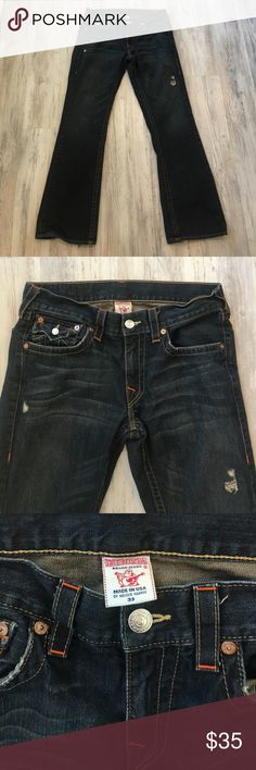 True Religion Boot Cut Jean Over all great condition. Clean dark was Denim. Boot cut style. Slight wear and tear on hem line on bottom. Pricing so you can have that fixed on your own. On from to Pant that rip is part of the style of the jean and came this way.  Waist 33 Inseam 31 True Religion Jeans Bootcut