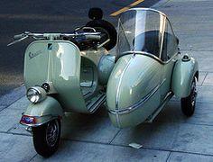 vintage vespa with a side car...