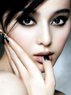 Black makeup, classy not goth.