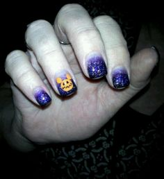 Halloween nails: black and purple/orange glitter fade with pumpkin Micky  Mouse nail art