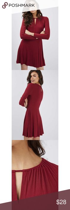 NWT Topshop Maroon Skater Dress size 8 NWT Topshop skater dress Beautfiul keyhole draping by the neckline Long sleeved Maroon in color Size 8 92% Viscose, 8% Lycra - Super soft and stretchy material Brand new, perfect condition!  armpit to armpit - 17 inches length - 36 inches Topshop Dresses