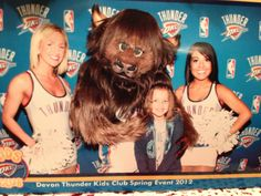 My daughter with Rumble the Bison and a few Thunder girls.