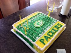 Green Bay Packers Cake with handmade edible white chocolate logo and goal posts.