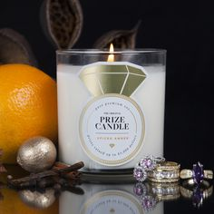 Spiced Amber - Prize Candle  Create an ambience of warmth with this rich blend of golden amber, orange, and smoky exotic spices and a touch of creamy vanilla. A modern classic for men and women.     Golden Amber, orange, cinnamon, blonde woods, vanilla and ginger.