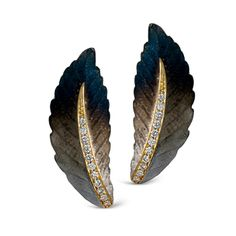 These luxurious 18K yellow earrings add .17ctw of round white Diamonds to this uniquely colorful pattern.    DE194