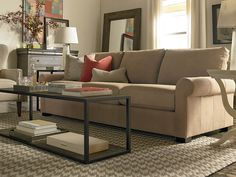 Scarborough Leather Sofa by Bassett Furniture features deeper seating for a comfortable, relaxing and luxurious experience.