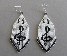 """Treble Cleft Earrings. Etsy $28+3 shipping. 1288 beads and silver plated french hooks. 1.25"""" wide x 3"""" long"""