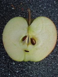 "This little apple has eyes that ""were  born to  be sad,"" according to the ancient Taoists."