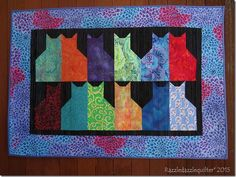 Mystic moggies wall hanging by Razzle Dazzle Quilter (New Zealand).  Kaffe Fassett border.