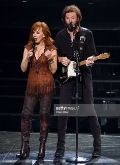Recording artists Reba McEntire (L) and Ronnie Dunn perform during the opening weekend of their residency 'Reba, Brooks & Dunn: Together in Vegas' with Kix Brooks (not pictured) at The Colosseum at Caesars Palace on June 19, 2015 in Las Vegas, Nevada.