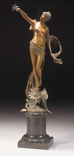 A PATINATED BRONZE FIGURE of a butterfly girl, cast from a model by F.Rosse, on mottled black marble base, signed in the bronze -- 46cm. high | CLASSIC ART NOUVEAU