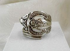 Spoon rings originated in 17th century England and were originally used as wedding rings. Servants could not afford to have wedding rings made of precious metals so they would steal the silverware from the manor houses.