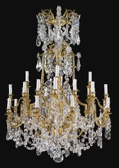 A LOUIS XVI STYLE GILT BRONZE AND MOULDED GLASS TWENTY-FOUR LIGHT CHANDELIER, France, circa 1880s.
