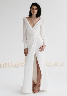KAREN WILLIS HOLMES : Wrap gown with side split skirt, cut out center back with georgette bell sleeves, finished with a tailored belt. Optional choices - no sleeves. Karen Willis Holmes, Wedding Gowns, Bridal Dresses, Bridesmaid Dresses, Dresses Dresses, Lace Wedding, The Knot, Different Dresses, Long Sleeve Wedding
