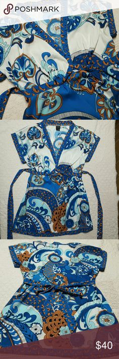 "NWOT - Nicole - Gorgeous Silk Ethnic Print Tunic Luxurious silk Nicole Miller tie back tunic top with plunging neckline and short crop sleeves. The ethnic and paisley print is very striking with beautiful blues, light brown and cream. 28"" long approx. measurement. Never worn or laundered. Nicole by Nicole Miller Tops Tunics"