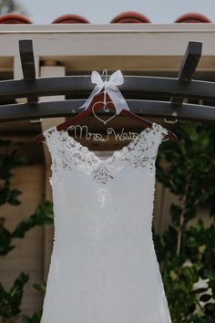I love the idea of having my new last name on the hanger for my wedding dress! This one is from www.rlhcreations.com.