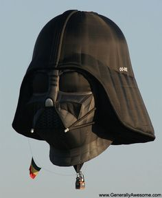 Hot air balloon in the shape of Darth Vader .... or darth vader's head from STAR WARS flying the belgian flag! go belgium!