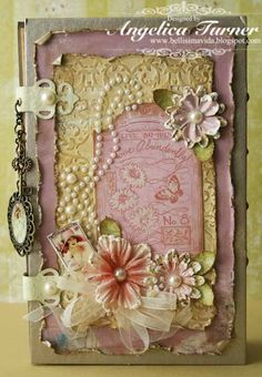 Adorable mini by Angelica Turner.  Great distressing!  Beautiful cover.