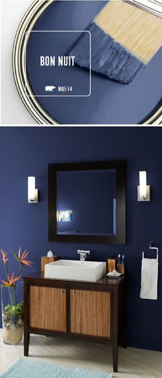 Bring a sense of elegance and drama into your home decor with the newest Color of the Month: BEHR Paint in Bon Nuit. This dark blue paint color evokes the feeling of the midnight summer sky on a clear night. This bathroom pairs the modern hue of this sapphire blue shade with black and wood accents to create a relaxing seaside spa vibe. Click here to see more.