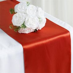 Burnt Orange Satin Table Runner | Satin has an unsurpassable sophistication and charismatic appeal about itself, it is undoubtedly, most preferred embellishing fabric that is adored by people all over the world and is tirelessly utilized in designing elegant formal attires, accessories, decorative flowers, ornaments and a lot more. The lustrous glossy texture of the fabric together with the seamless sheen and sublime elegance it exudes make it everyone's favorite all around the world. Spread…