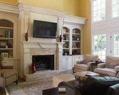 ~Country French Fireplace TV Design, This is it. Love the arch and moulding.  No step.  Bring out forward.  Side sconces.
