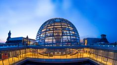 Reichstag Dome in Berlin, Germany (© Holger Mette/Shutterstock) above the debating chamber of the Bundestag, the German parliament, the dome of the Reichstag in Berlin was completed in 1999 to symbolize Germany's reunification. Architect Norman Foster's glass dome design for the new cupola harkens back to the glass and steel dome that once topped the German parliamentary building.