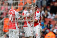 Santi Cazorla and Wilshere celebrate with Walcott after the Arsenal forward netted his hat-trick goal against the Baggies - 4-1 at the Emirates on 24 May 15