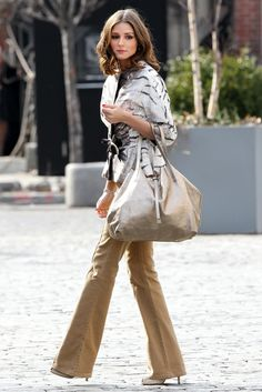 Olivia Palermo in tan wide leg trouser and animal print fur? jacket