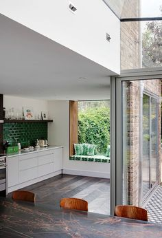 Bottle green subway tiles, parquet flooring - stunning! Eclectic Kitchen by Brian O'Tuama Architects