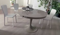 ECLIPSE, design: Studio Ozeta - Extendable dining table with metal central column, glass top and inside painted melamine extension. www.ozzio.com