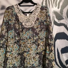 Floral cape sleeved top Floral cape sleeved top. Flowy and gorgeous! Size small. 100% polyester. In perfect NWOT condition. Brand is Trinity bought on Zulily. Trinity Tops Blouses