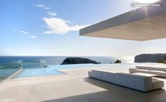 Swimming Pool in Spain featuring hillside views over the Mediterranean Sea. Image via Houzz.com