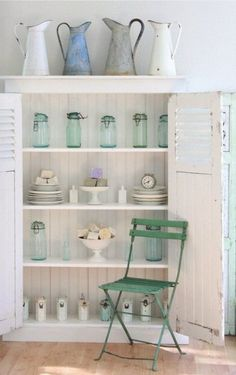 White wood and sea foam green makes this cabinet perfect for a beach house.