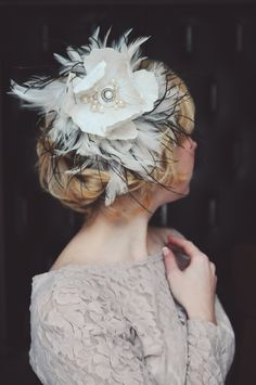 White wedding fascinator with vintage flower, brooch, pearls and feathers. $228.00, via Etsy.