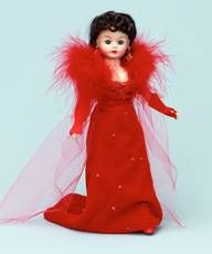"""$107.96 Scarlett O'Hara The Red Velvet Ball Gown 10"""". Scarlett O'Hara is simply scandalous but yet so beautiful in her Red Velvet Ball Gown. She is a 10"""" bent knee Cissette doll, with green eyes and soft brunette curls that form a low bun in back. She wears a red velvet gown trimmed with sequins and beads. Red marabou feathers on the detachable sleeves add a glamorous touch. Underneath, she wears a lace trimmed.....Full product description @ duchessoutlet.com"""