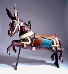 Carousel Donkey by Gustave Bayol  Vers 1900  Bois de tilleul sculpté et peint  Accessoires : cuir, laiton, bronze, pâte de verre.  156 x 180 x 40 cm  Œuvre des collections nationales