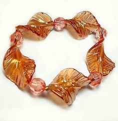 SALE Iridescent Unique Opal Peach Twisted Leaf Beaded Stretch Bracelet w/Rose Petal Pink GemCut Beads & Mini Gold Ball Accents FREE SHIPPING - Only $5.95 on Etsy! https://www.etsy.com/listing/216910571/sale-iridescent-unique-opal-peach