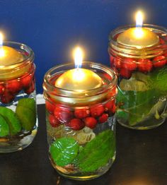 Floating candles with bay leaves and cranberries in a mason jar