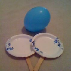 My 3 year old loves balloon tennis.  All you need to do is staple plates to paint sticks, grab a balloon,and start hitting it.