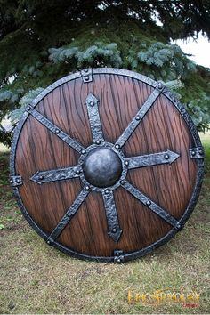 Iron reinforced wooden Shield of Finding  +1 to Navigation/Directional skill checks above ground/outdoors