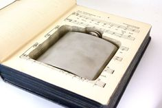 Flask Book with Hidden Flask made from #recycled book -- no two are alike. Witty #gift for yoursel or anyone who enjoys both literature and #hooch.$50.