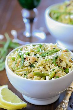 This Spring Orzo Salad is a beautiful orzo pasta salad filled with orzo, asparagus, toasted almonds, arugula, feta cheese and peas tossed with a delicious vinaigrette. You won't be able to resist it! It's the perfect salad for spring and summer! Chicken Marinade Recipes, Beef Recipes, Healthy Recipes, Orzo Salad Recipes, Pasta Salad With Tortellini, Breaded Pork Chops, Healthy Baked Chicken, Toasted Almonds