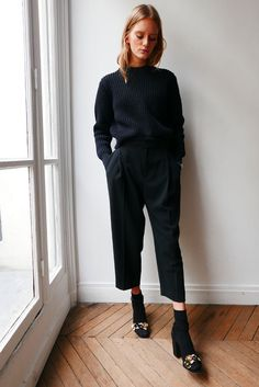 All-black with a tucked jumper and black socks with embellished sandals.