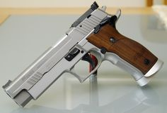 Sig Sauer X5..... it's beautiful and can also kick a tin can's ass.