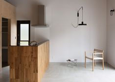 Japanese studio CAPD has used large wooden boxes to created rooms and mezzanine floors within a house in Tokushima Prefecture