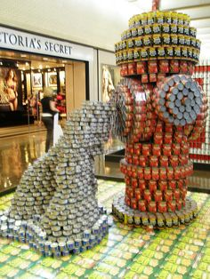 Extinguish Hunger. It's the title of this CANstruction benefiting the North Texas Food Bank.  Personally, I was drawn to the metaphor of this CANstruction because hunger can be like a fighting a fire; hunger can strike indiscriminately but the devastation is minimized when a well-stocked and volunteer-supported food bank exists for the community.